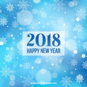Flat new year 2018 background in blue with snowflakes