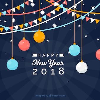 カラフルな旗と球でフラットな新年の背景