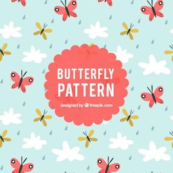 Modello piatto con le farfalle e nuvole