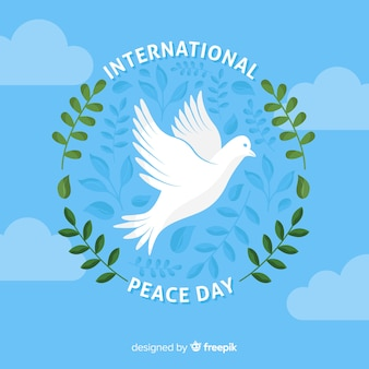 Flat peace day background with dove