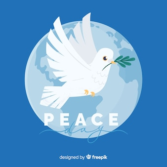 Flat peace day background with a dove