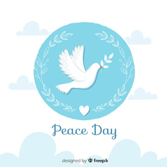 Flat peace day with dove and olive leaves