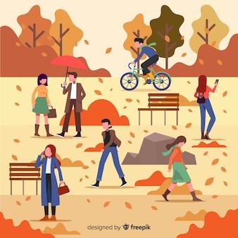 秋に歩いている平らな人々