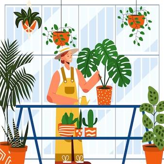 집에서 식물을 돌보는 편평한 사람