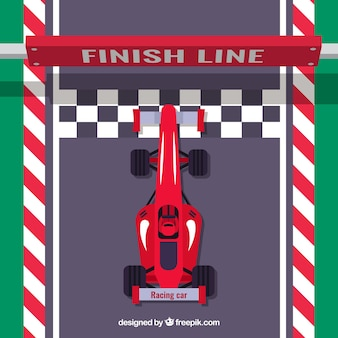Flat red f1 racing car crosses finish line