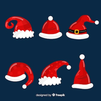 Flat santa's hat collection on blue background