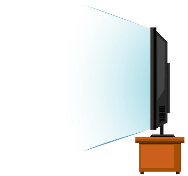木製のテーブルにフラットスクリーンテレビ