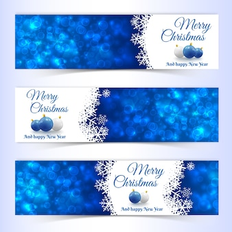 Flat set of horizontal new year and christmas banners decorated with balls and snowflakes