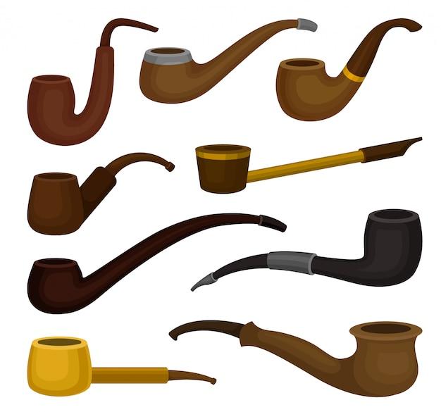 Плоский набор различных видов табачных трубок. старинные деревянные трубки для курения. классический аксессуар для курящих