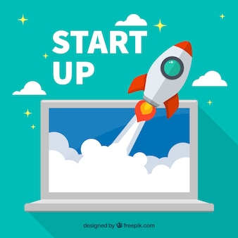 Piatto start up concept con razzo e laptop