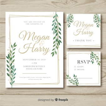 Flat wedding stationery template on wooden background Premium Vector