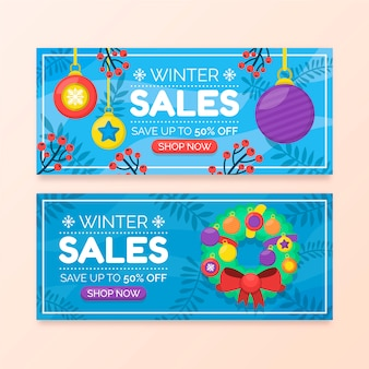 Flat winter sale banners with wreath and christmas balls