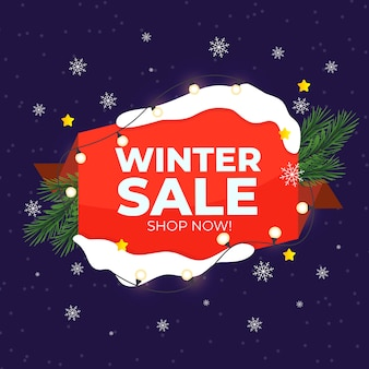 Flat winter sale with string lights and pine leaves