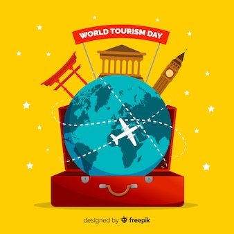 Flat world tourism day in a luggage