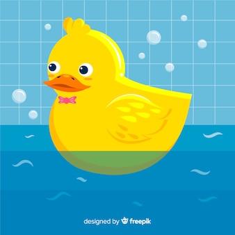 Плоская желтая резиновая утка в ванне