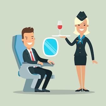 쟁반에 레드 와인 한 잔과 함께 비행기 스튜어디스에 앉아 플랫 젊은 웃는 사업가