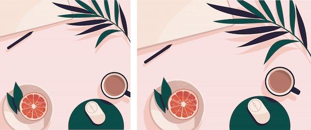Flatlay с ноутбуком, тарелка с грейпфрутом, чашка чая и пальмовых листьев