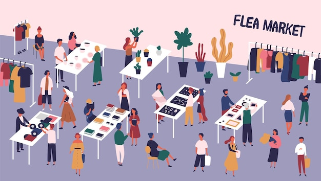 Flea market with people walking among counters and buying goods
