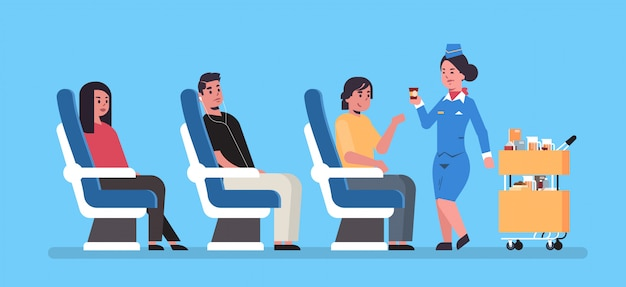 Flight attendant serving drinks to airplane board passengers sitting in armchairs stewardess in uniform pushing trolley cart professional service travel concept