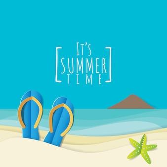 Flip flops slipper and starfish on sandy beach