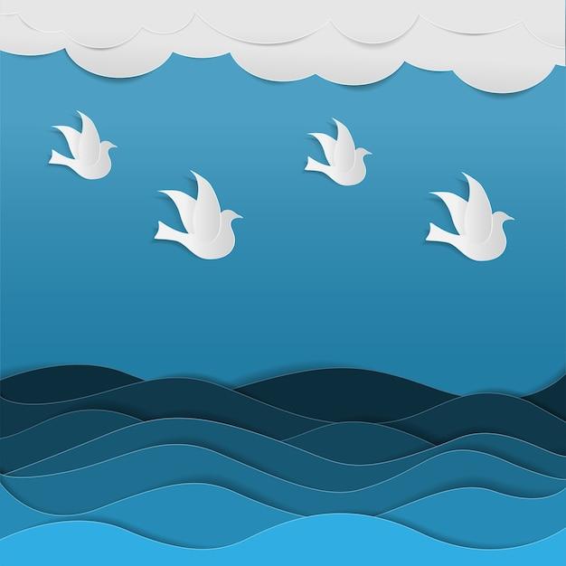 空を飛んでいる鳥の群れ青い海の中を紙アートスタイルで飛ぶ