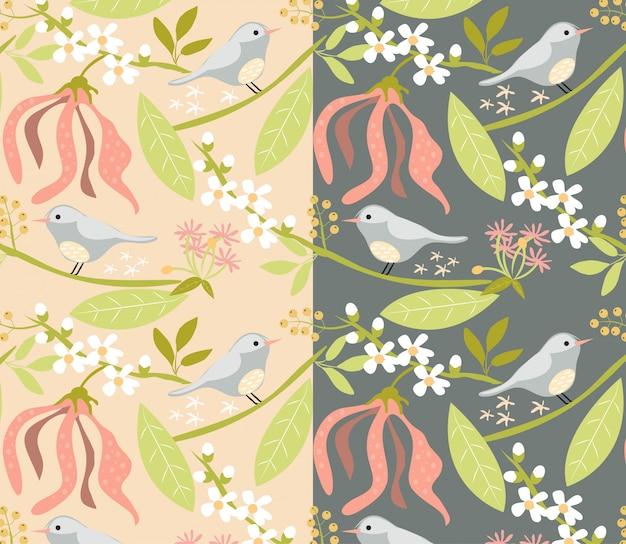 ピンクと濃い灰色の背景に花柄と鳥柄