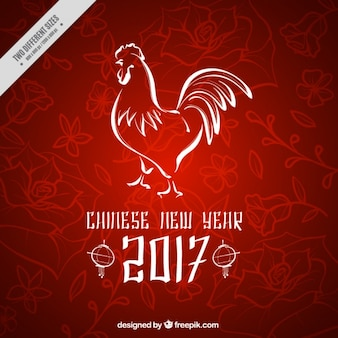 中国の旧正月のためのオンドリと花の背景