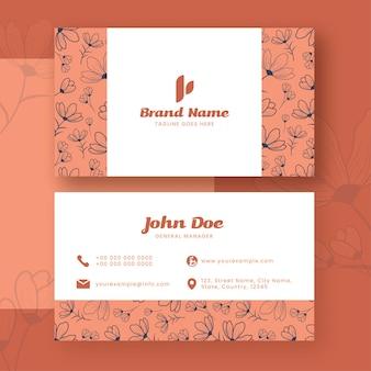 Цветочный дизайн шаблона визитной карточки в белый и оранжевый цвет.