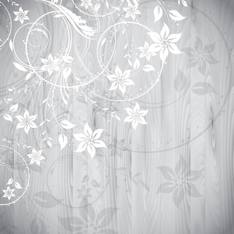 Floral elements on a wooden background