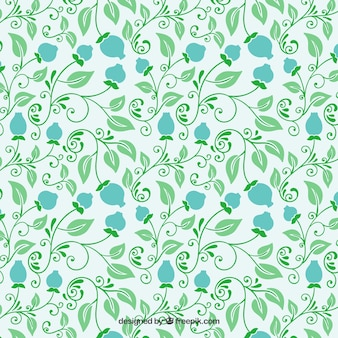 Floral pattern in green and blue tones Free Vector
