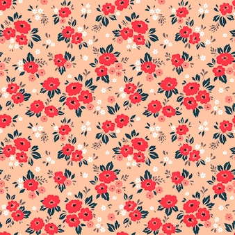 Floral pattern. pretty flowers, coral background. printing with small red flowers. ditsy print