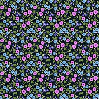 Цветочный узор. красивые цветы, темно-синий фон. печать с мелкими цветами. ditsy print
