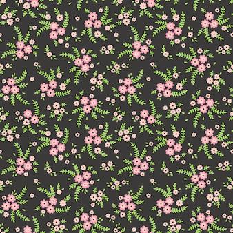 花柄。きれいな花、濃い緑色の背景。小さなピンクの花で印刷。ちっぽけなプリント