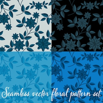 Floral pattern with white flowers and blue leaves on blue back background.