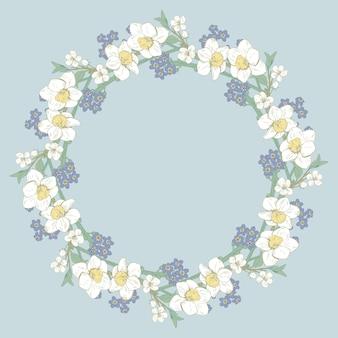 Floral round frame on blue background.