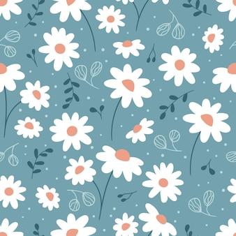 青い背景にカモミールと抽象的な葉を持つ花のシームレスなパターン