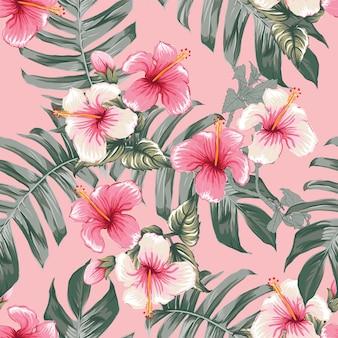 ピンクのハイビスカスの花と花のシームレスなパターン