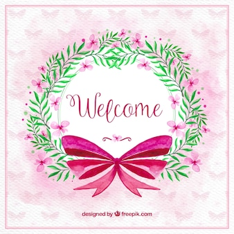 Floral watercolor wreath with pink bow