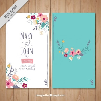 Floral wedding card on a turquoise background