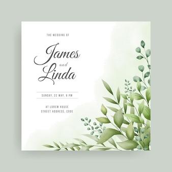 手描きの葉のデザインと花の結婚式の招待カードのテンプレート