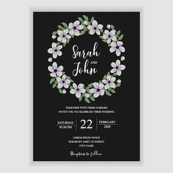 Floral wedding invitation card with cherry blossom decoration