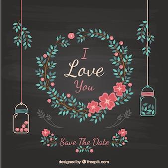 黒板に花の結婚式の招待状