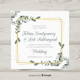 Floral wedding invitation template with elegant golden frame