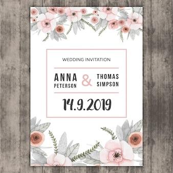 Floral wedding invitation on wood