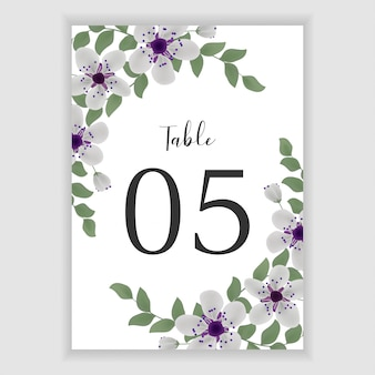 Floral wedding table number with purple bouquet