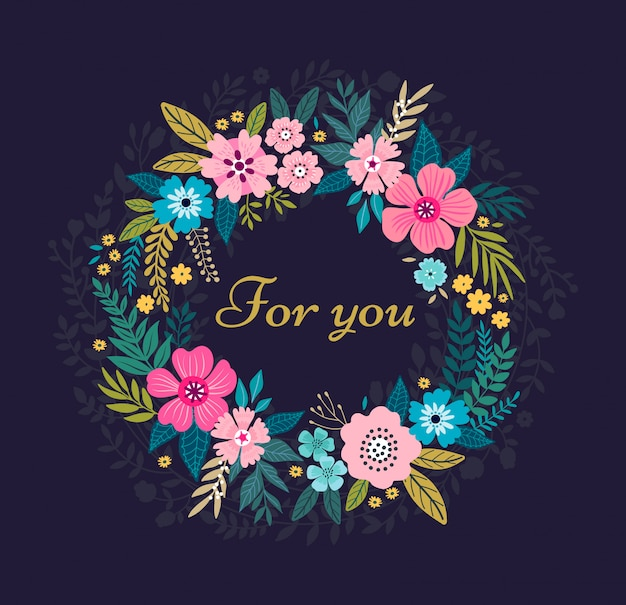 Floral wreath on black background. bright colorful spring flowers.