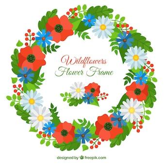 赤い花とヒナギクと花の花輪