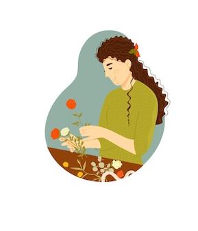 孤立した花をアレンジする花屋の女性人