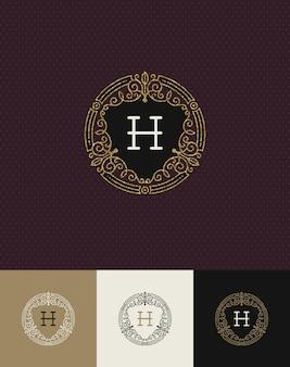 - процветает блестящий золотой монограммный логотип.