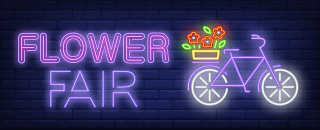 Flower fair neon text, bicycle with flowers on luggage carrier